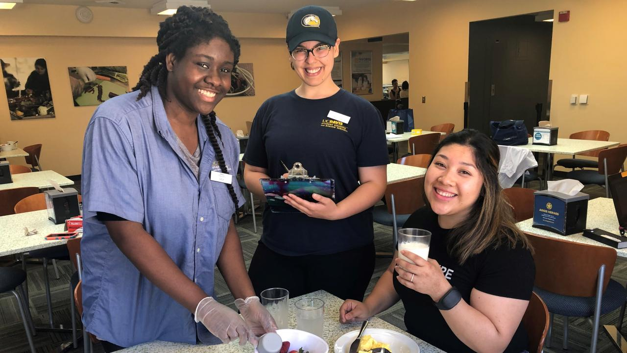 Undergraduate research interns Adaeze Ezeagwula, Jewel Esparza, Melanie Hercules (left to right) measuring dietary intake of study participants at Cuarto Dining Commons